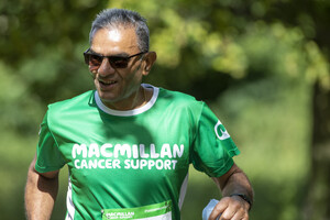 A male runner smiling in the sunshine at Run Regents Park 2019